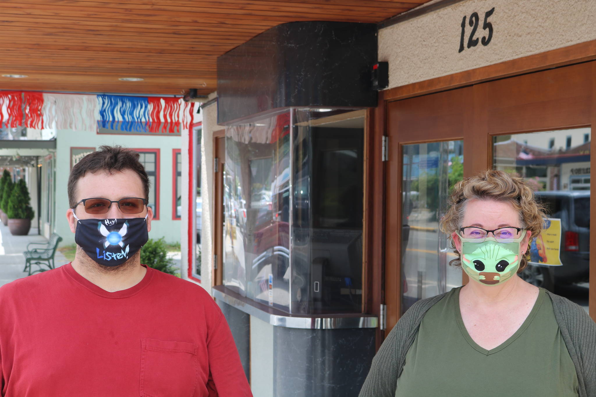 File photo Beth Burrows, owner of the North Bend Theatre, stands outside the theater with manager Skyler Possert in this July 2020 photo.
